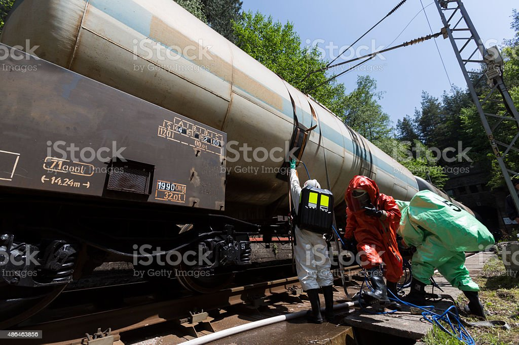 Toxic chemicals acids emergency team near train stock photo