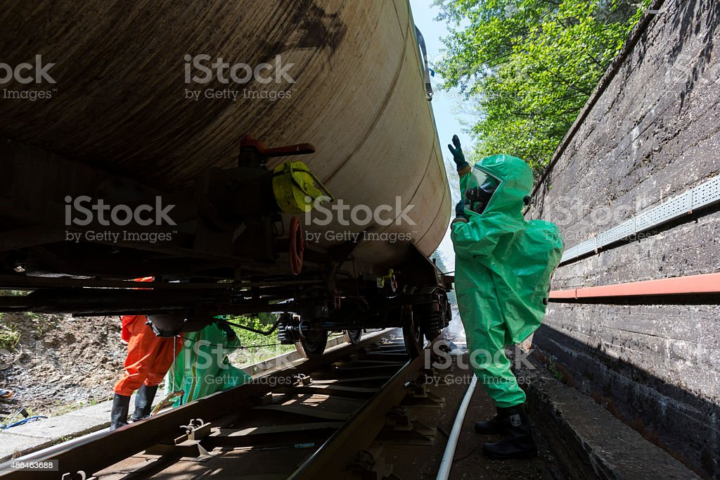 Toxic chemicals and acids emergency team checking tank stock photo