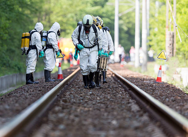 Toxic chemicals and acids emergency team A team working with toxic acids and chemicals is approaching a chemical cargo train crash near Sofia, Bulgaria. Teams from Fire department are participating in an emergency training with spilled toxic and flammable materials. decontamination stock pictures, royalty-free photos & images