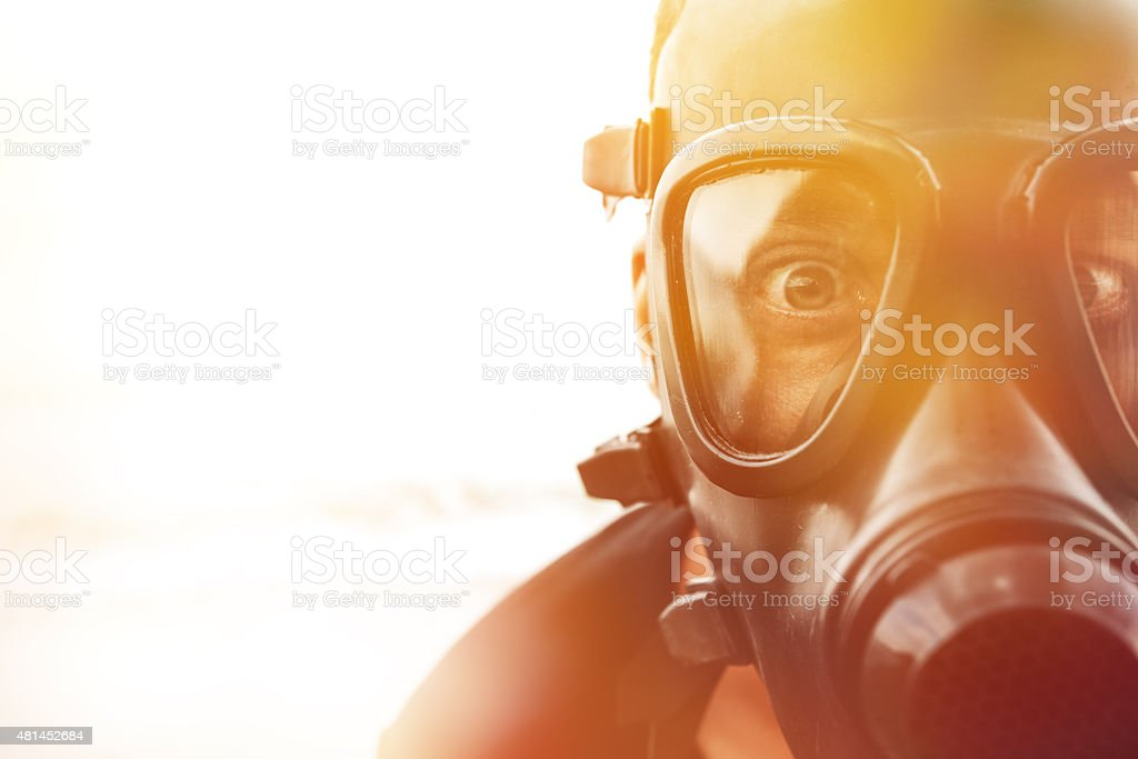 toxic environment scared man portrait with big eyes wearing toxic mask, toxic environment concept.sunlight, 2015 Stock Photo