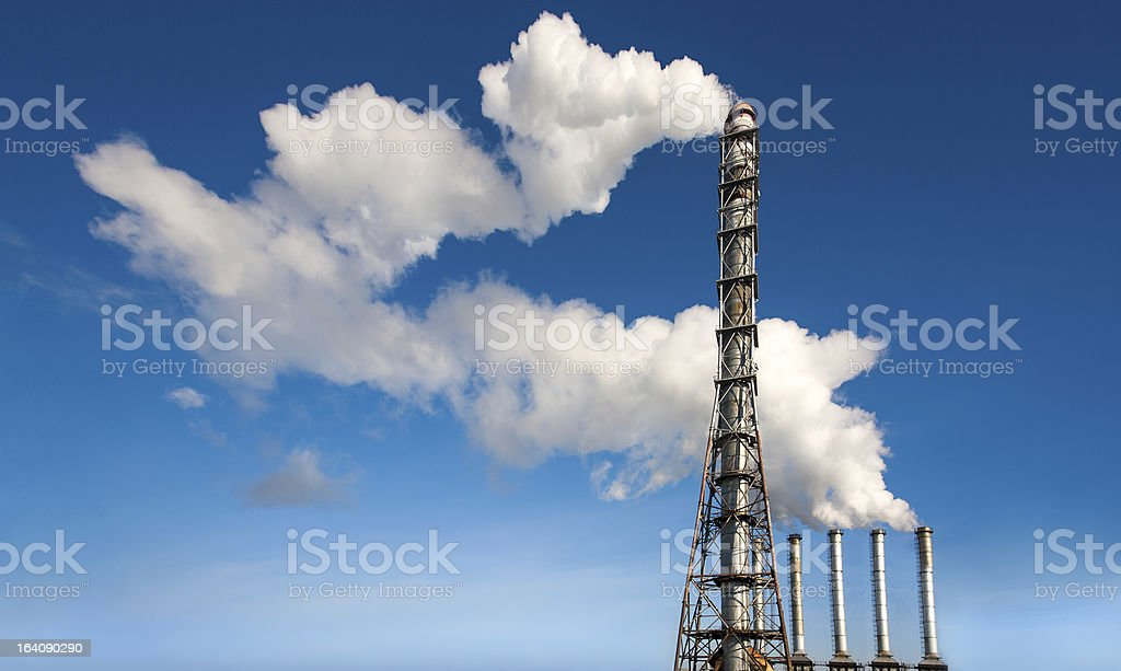 toxic industrial smoke from chimney on blue sky royalty-free stock photo