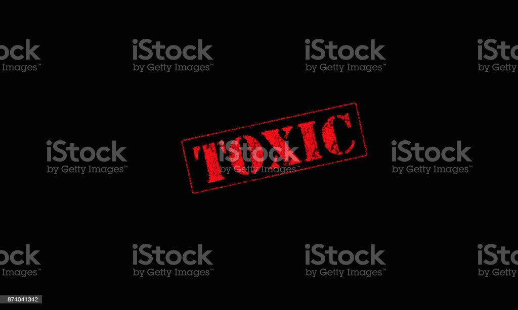 toxic rubber stamp on a black background red letters stock photo