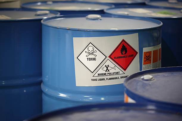 Toxic Substance In barrels in a factory. hazardous chemicals stock pictures, royalty-free photos & images