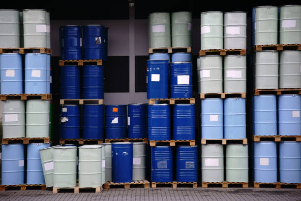 Toxic waste chemical plant The storage of toxic waste and chemicals in metal cans on the factory premises of a chemical plant. toxic waste stock pictures, royalty-free photos & images