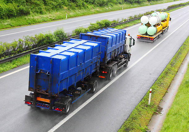Toxic waste transport. Trucks with toxic waste on the highway. Industry and pollution concept. toxic waste stock pictures, royalty-free photos & images
