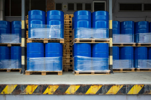 Toxic waste/chemicals stored in barrels at a plant Toxic waste/chemicals stored in barrels at a plant - cans with chemicals, industry oil barrels, chemical tank, hazardous waste, chemical reagents, ecological concept drum container stock pictures, royalty-free photos & images