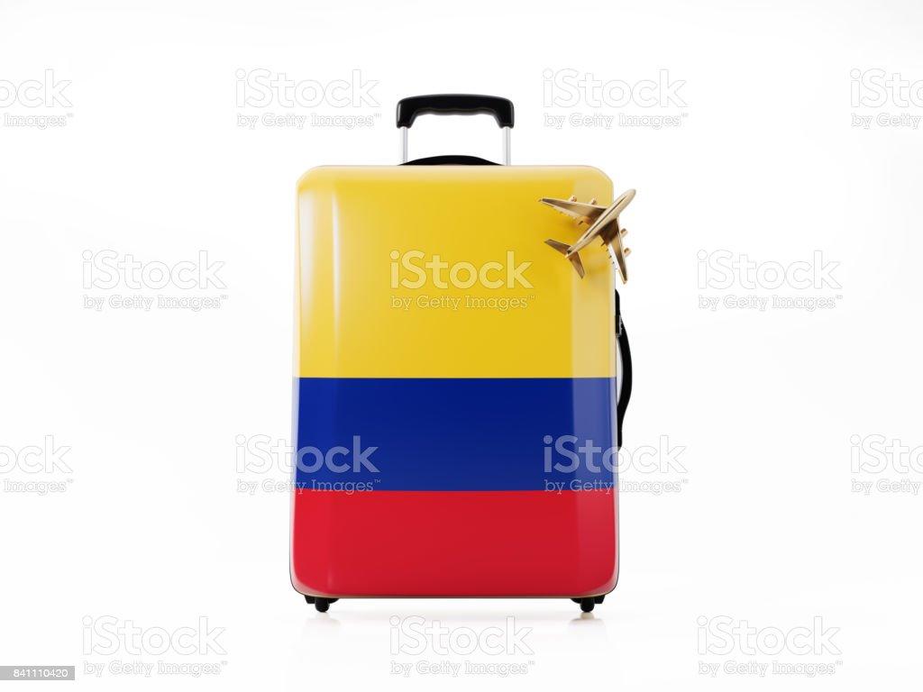 Juguete avión y equipaje moderno texturado con bandera colombiana: concepto de viaje - foto de stock