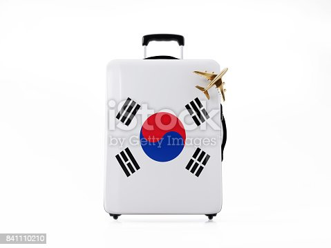 Modern Luggage  textured with South Korean flag. There is a toy airplane on the luggage demonstrating flying. Isolated on white background, Clipping path is included. Horizontal composition with copy space.