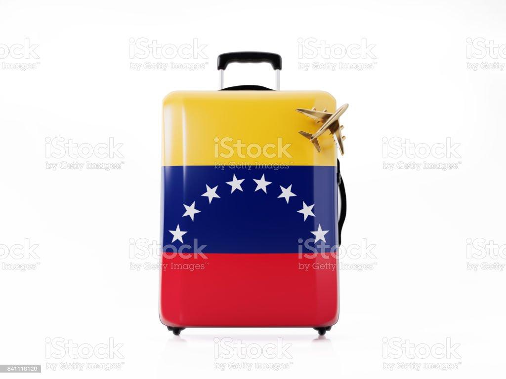 Juguete avión y equipaje moderno texturado con bandera venezolana: concepto de viaje - foto de stock