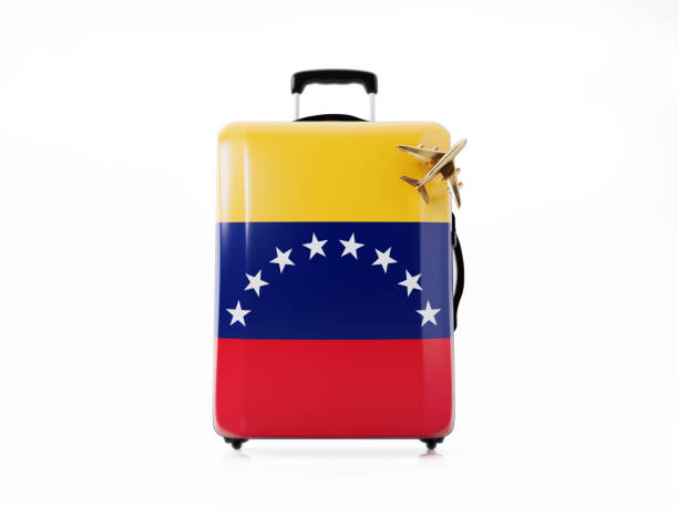 toy airplane and modern luggage  textured with venezuelan flag : travel concept - venezuelan flag stock photos and pictures