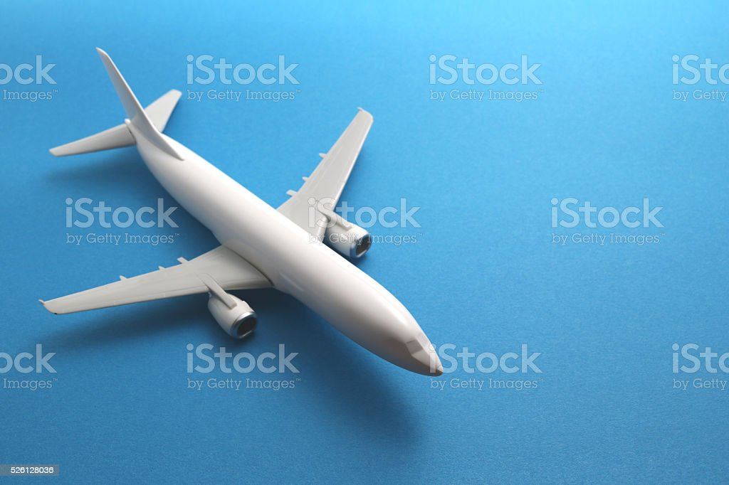 Toy airplane on blue background. stock photo