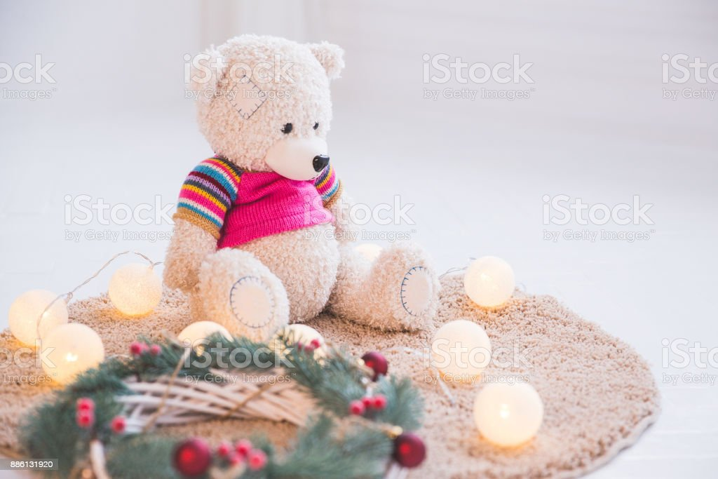 Toy and a Christmas decorative wreath on the carpet. stock photo