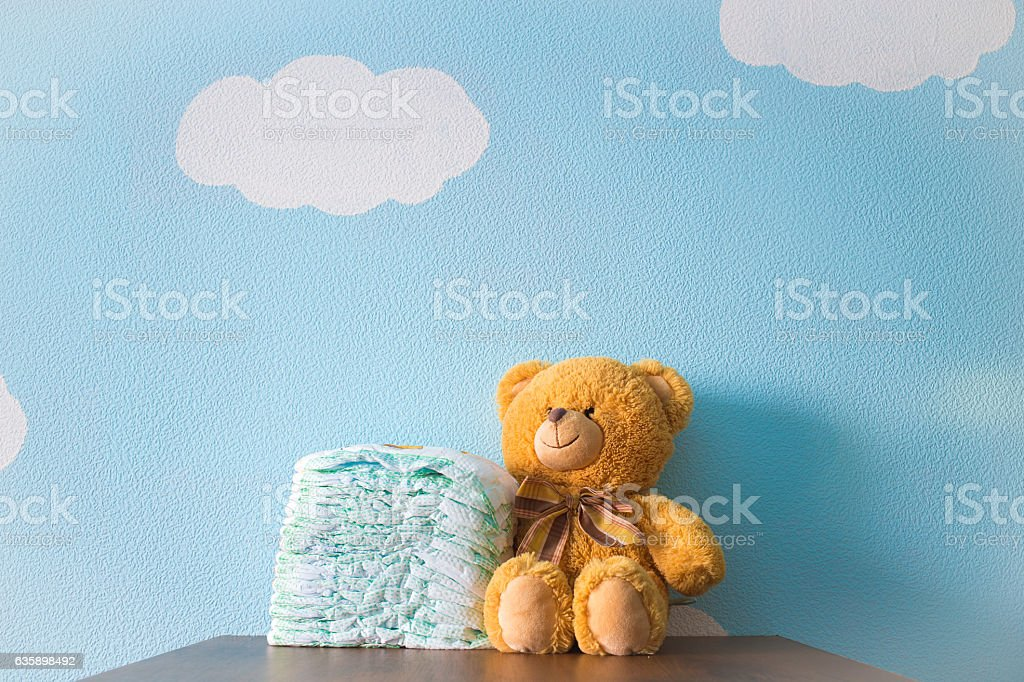 Toy and diapers stock photo