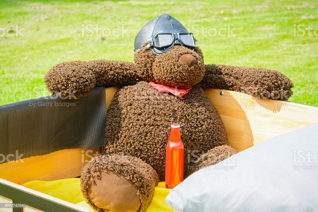 Toy bear sitting in a pick up truck stock photo