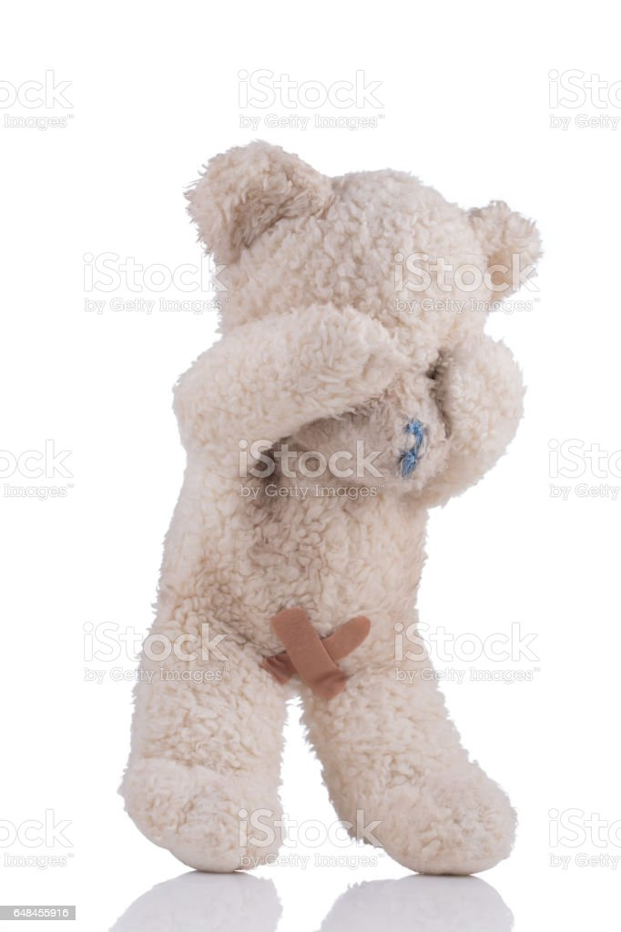 Toy bear with adhesive bandages on his private parts – Foto