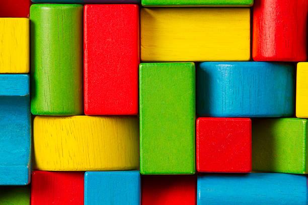 toy blocks background, organized children building bricks - spielesammlung stock-fotos und bilder