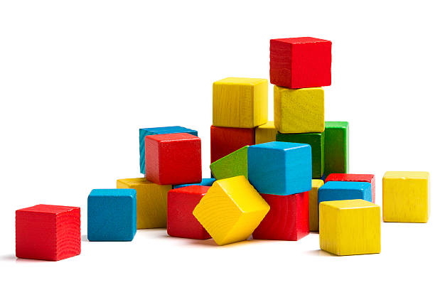 toy blocks pyramid, multicolor wooden bricks stack isolated white background - lego stok fotoğraflar ve resimler
