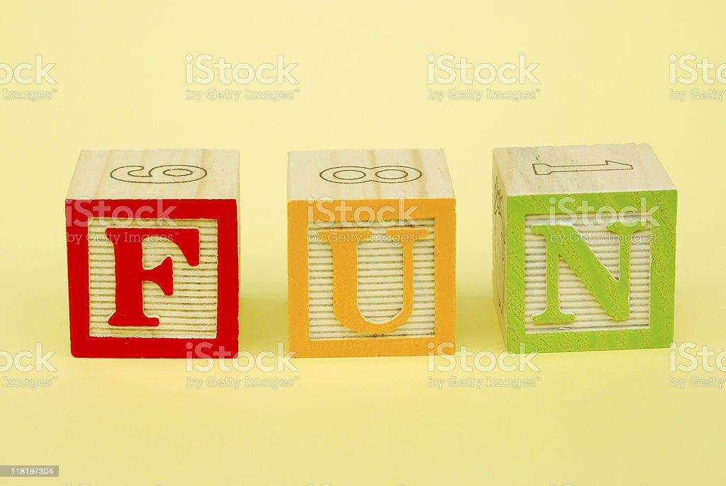 Toy blocks spelling FUN royalty-free stock photo