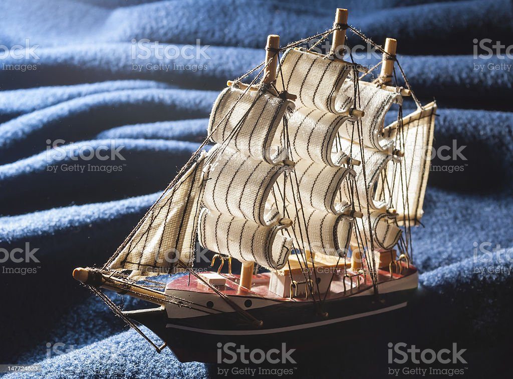 Toy boat on the waves. stock photo