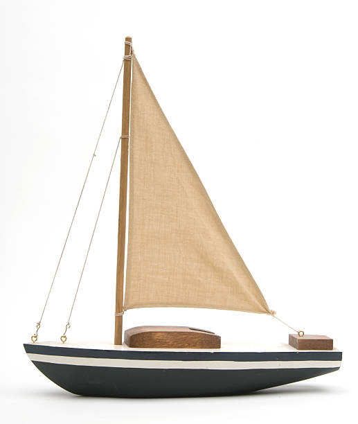 toy boat with a large brown sail - segelbåt bildbanksfoton och bilder