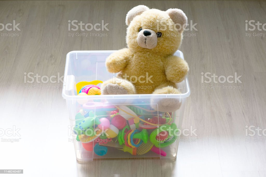 Teddy bear and toy box