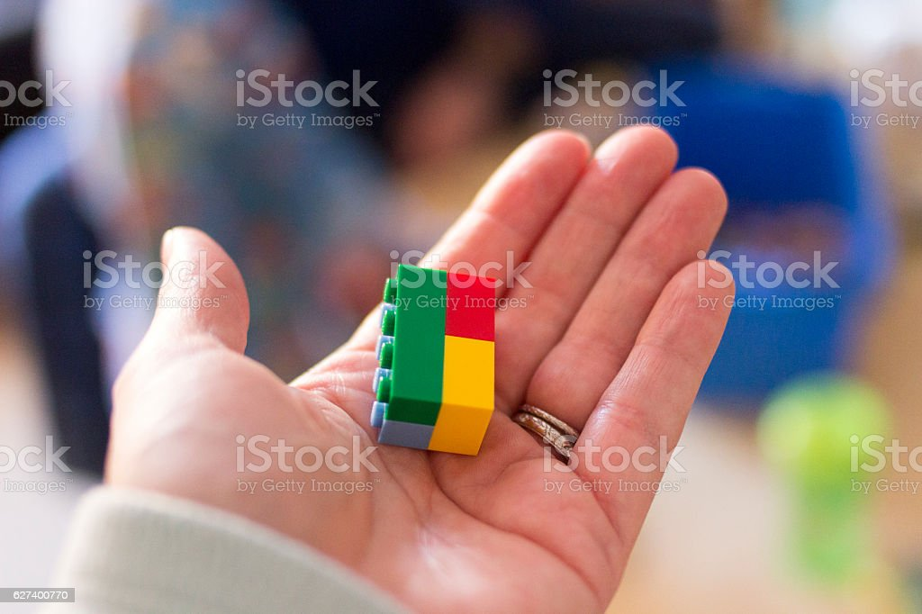 Toy Building Blocks in Woman's Hand stock photo