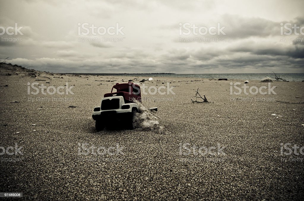 Toy car in sand royalty-free stock photo