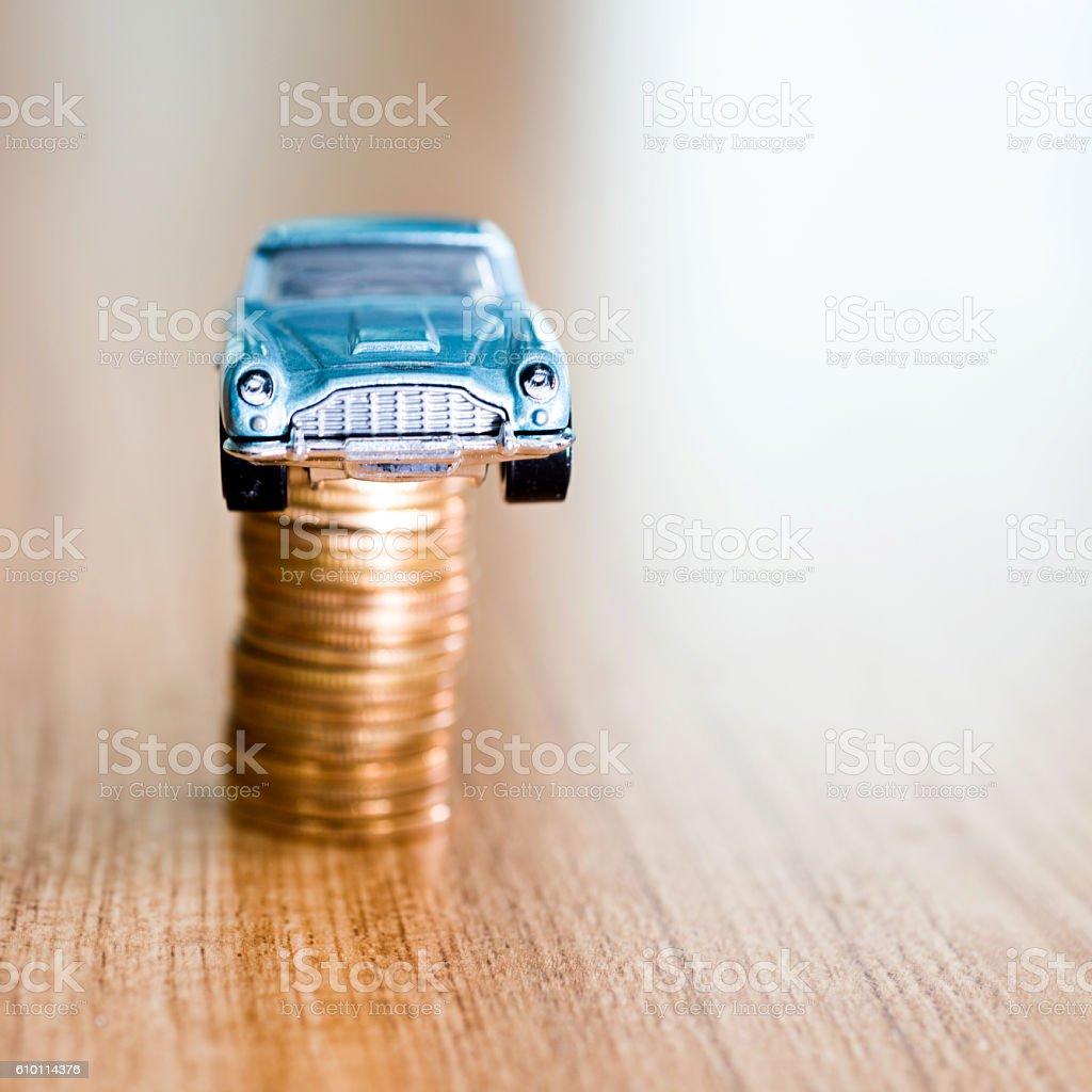 Toy car on coin stack stock photo