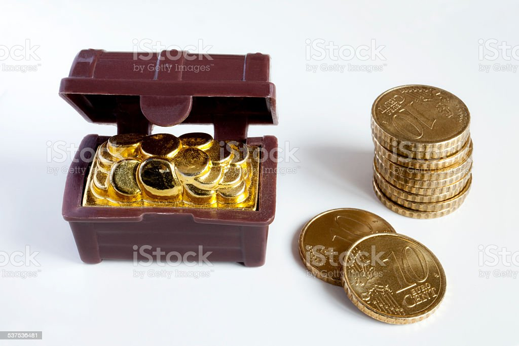 Toy chest and coins stock photo
