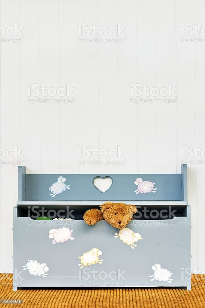 Toy chest with teddy bear stock photo