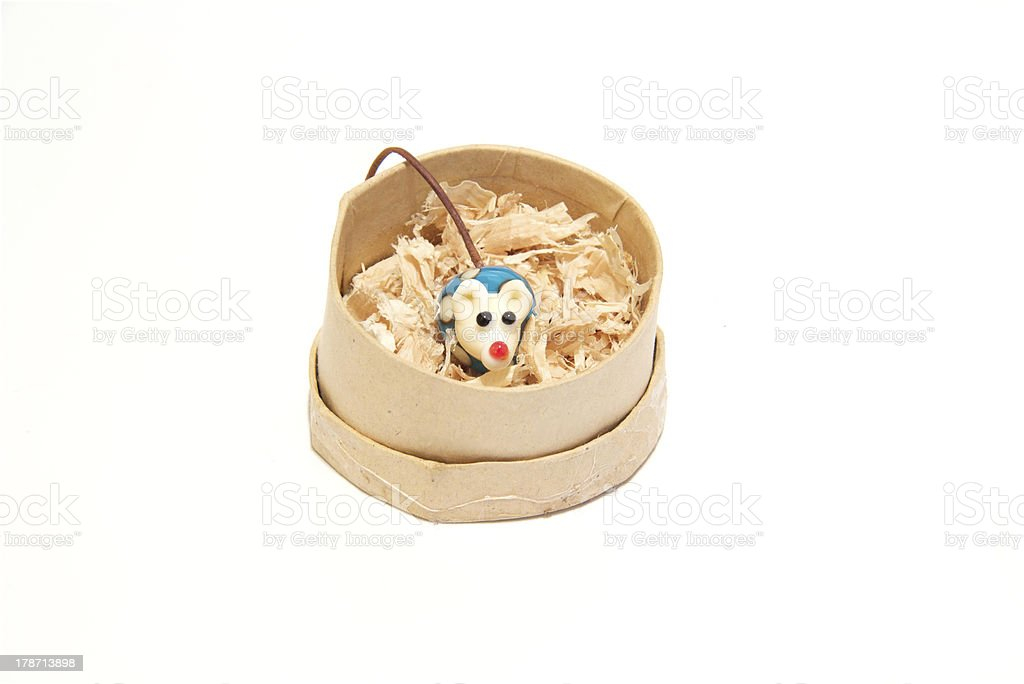 Toy china mouse in a round box royalty-free stock photo