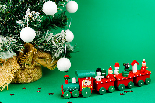 Toy christmas train with glittered stars