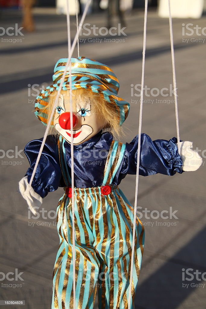 Toy clown with red nose. Puppet on a string royalty-free stock photo