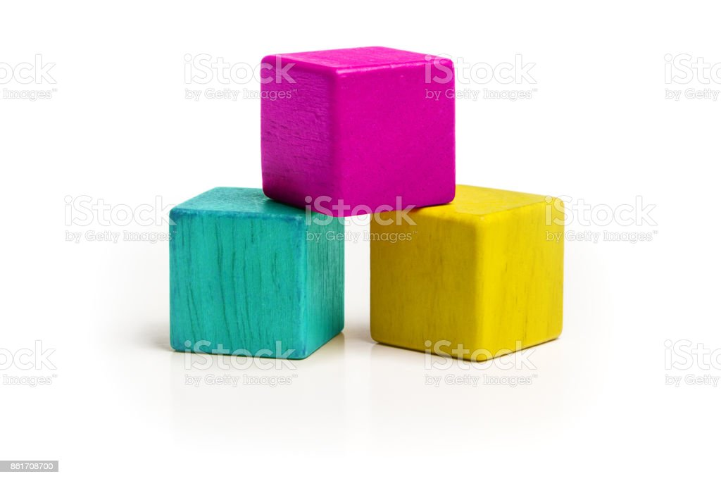 Toy Cube Blocks, CMYK Color Isolated over White Background, Three Kids Wood Toys, Cyan Magenta Yellow colors stock photo