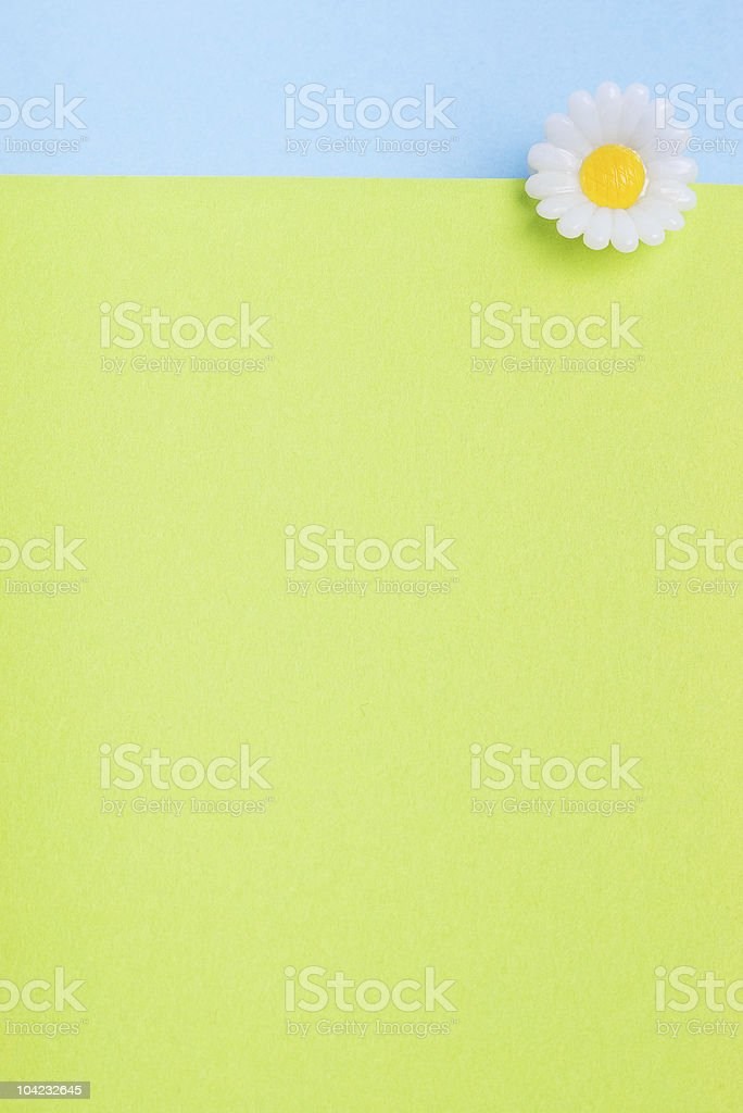 toy flower on top of green paper texture royalty-free stock photo