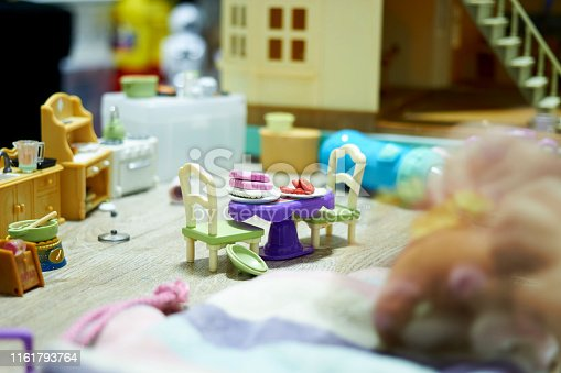 Toy foods on table in doll house