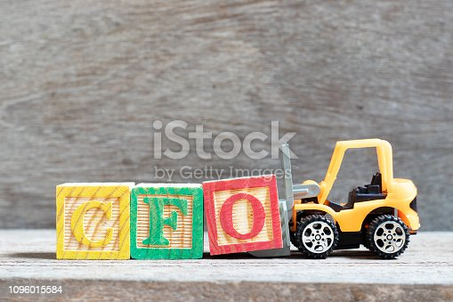 istock Toy forklift hold letter block O to complete word CFO (Abbreviation of Chief Financial Officer) on wood background 1096015584
