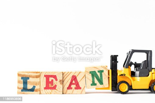 1180722244 istock photo Toy forklift hold wood letter block n to complete word lean on white background 1186950696