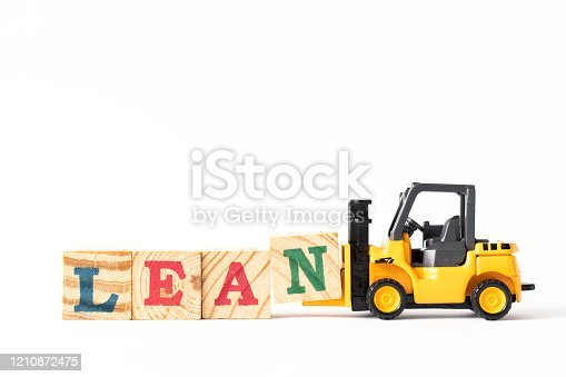 1180722244 istock photo Toy forklift hold wood letter block n to complete word lean on white background 1210872475