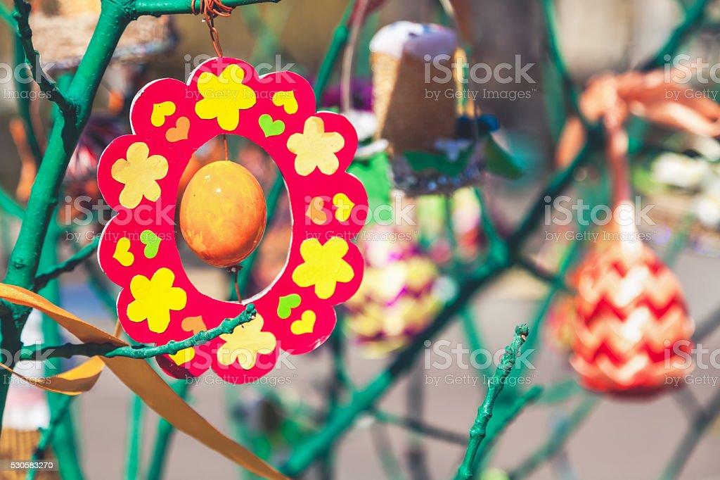 Toy handmade hanging on tree branch stock photo