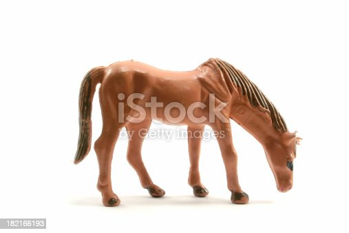 Plastic toy horse against a white background