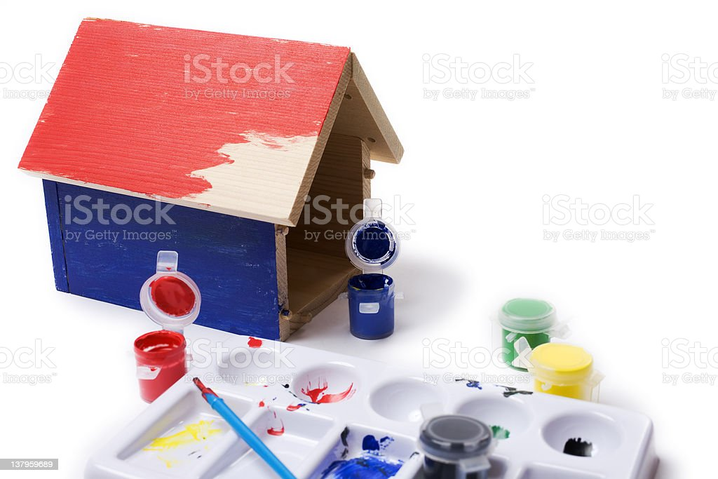 Toy house being painted royalty-free stock photo