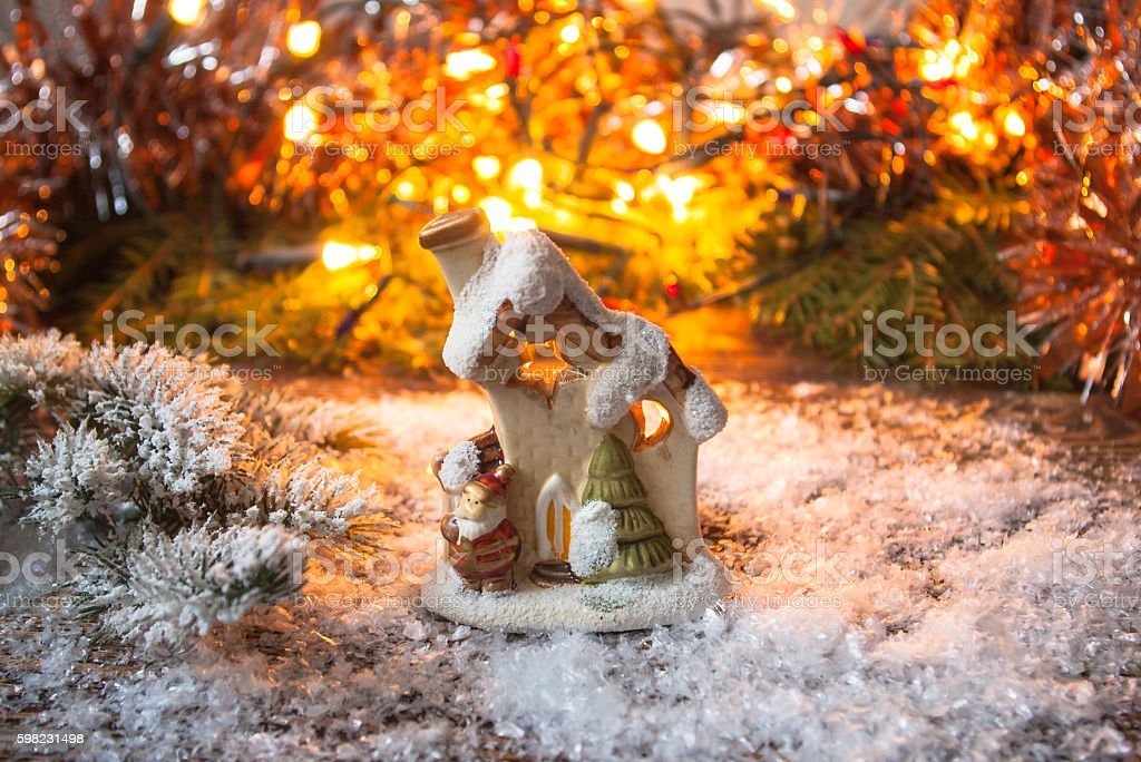 Toy house is standing in the snow. foto royalty-free