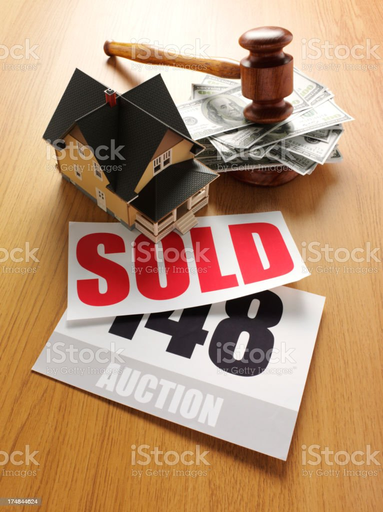 Toy House on American Dollars with a Sold Sign stock photo