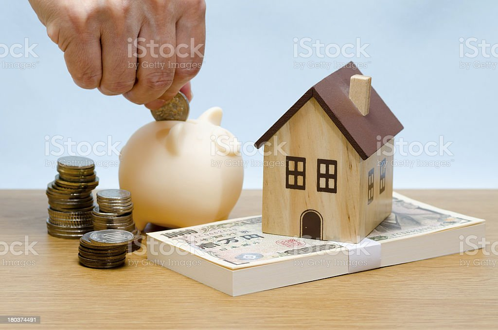 Toy house on the bankroll royalty-free stock photo