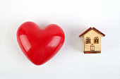 A toy house with a model of heart
