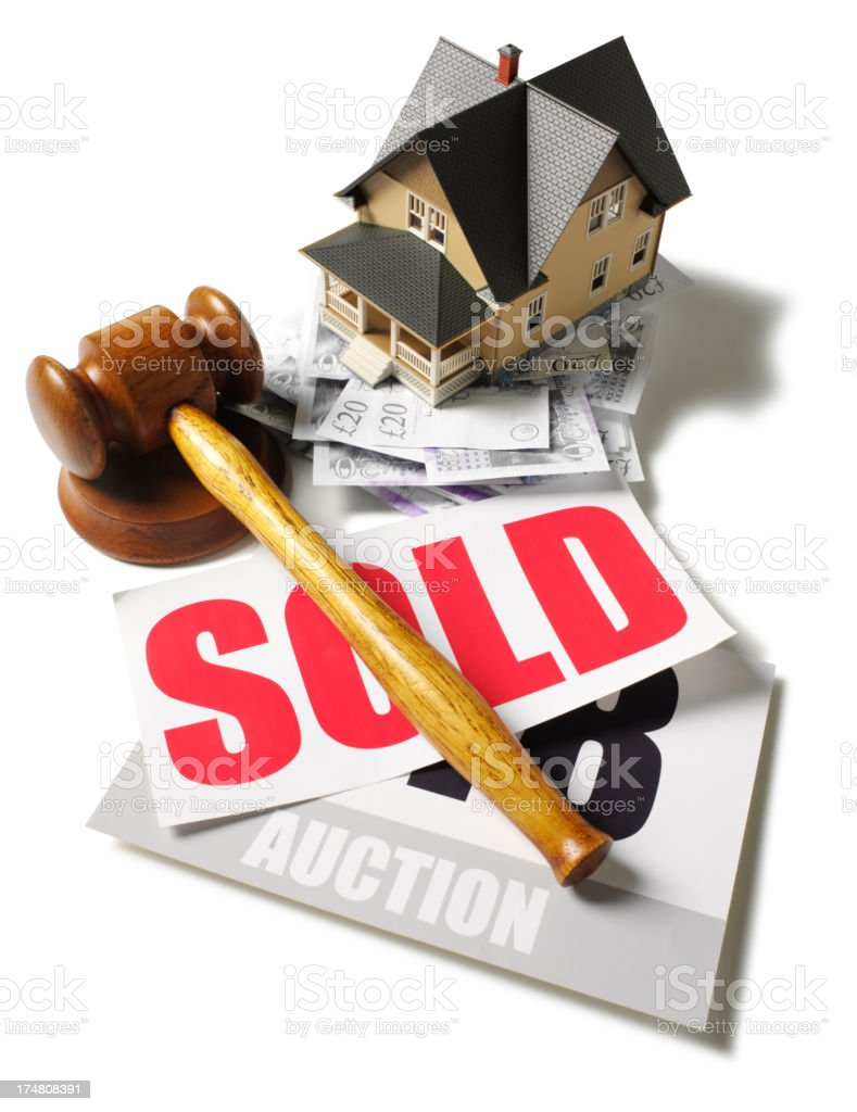Toy House with British Pounds at an Auction royalty-free stock photo