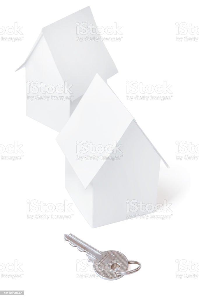 Toy houses and key, isolated. stock photo