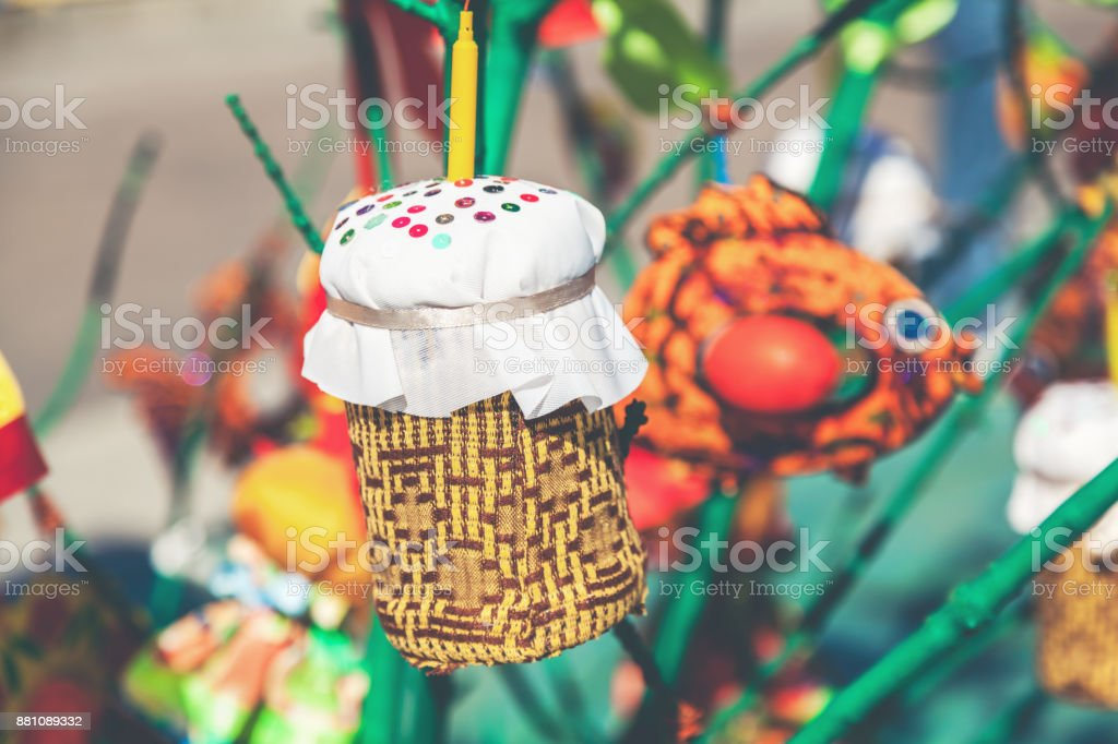 toy in form of cake hanging on tree branch stock photo