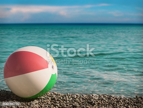 istock toy inflatable ball on the beach against the sea 500004720